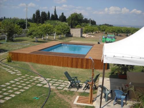 Piscina fuori terra con solarium priolo gargallo for Offerte piscine fuori terra