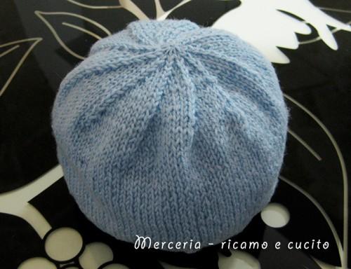 Cappellino in lana per neonato con spirale